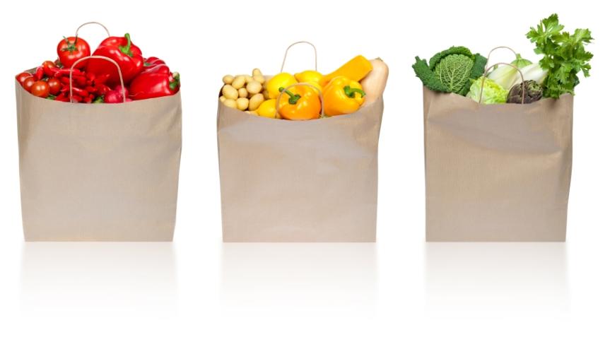 red green yellow vegetable composition in paper shopping bag iso